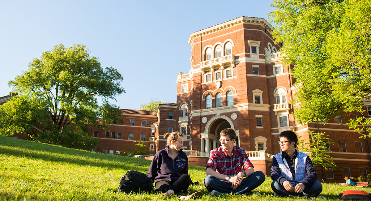 A group of students sit in the grass and relax on Oregon State's Corvallis campus.